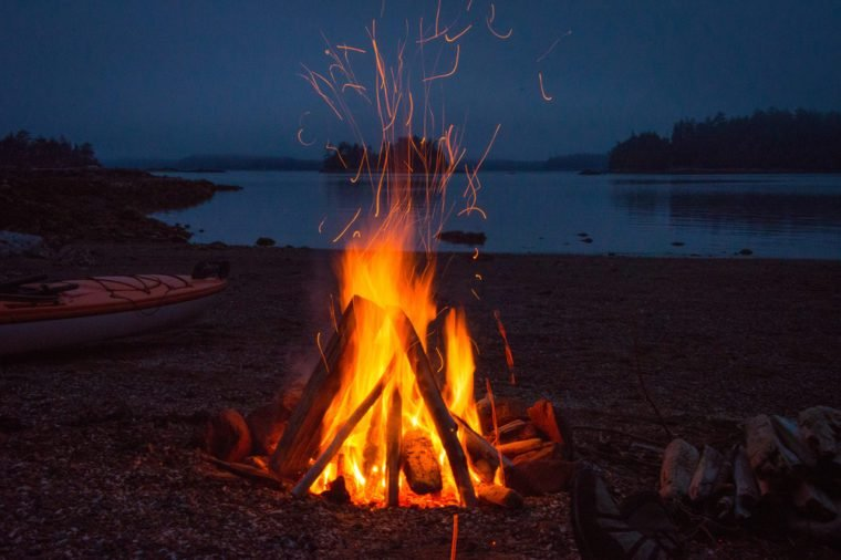Campfire evening. Kayak camping in the Broken Group Islands off the west coast of Vancouver Island.
