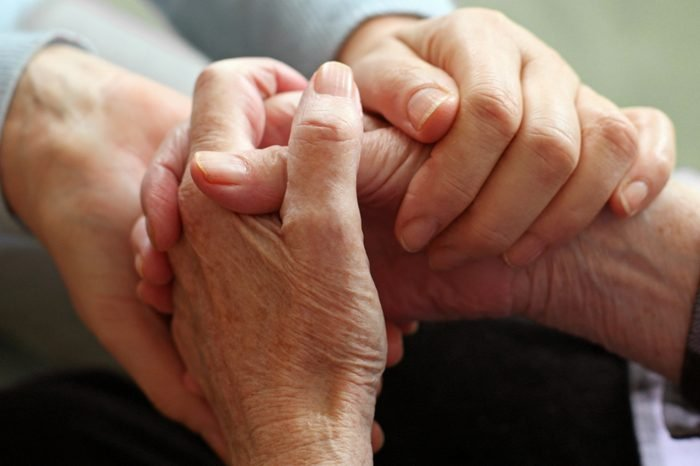 two pairs of hand touch each other, together, helping hands