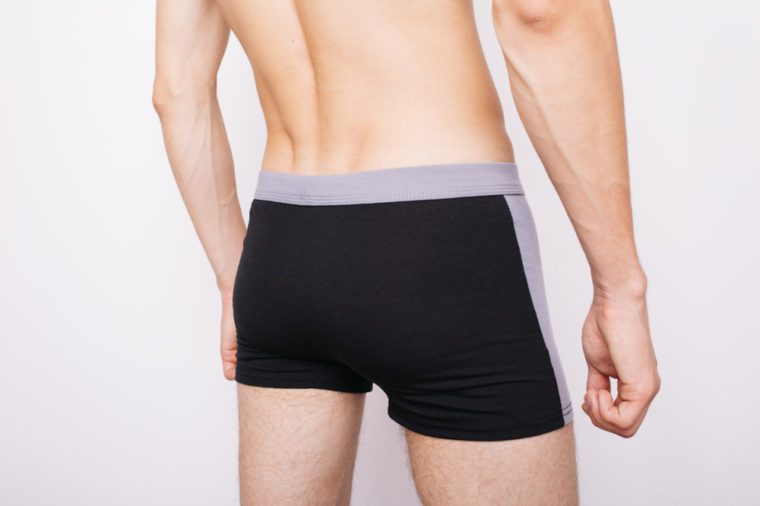 young guy in boxer shorts. underwear for men. tight ass