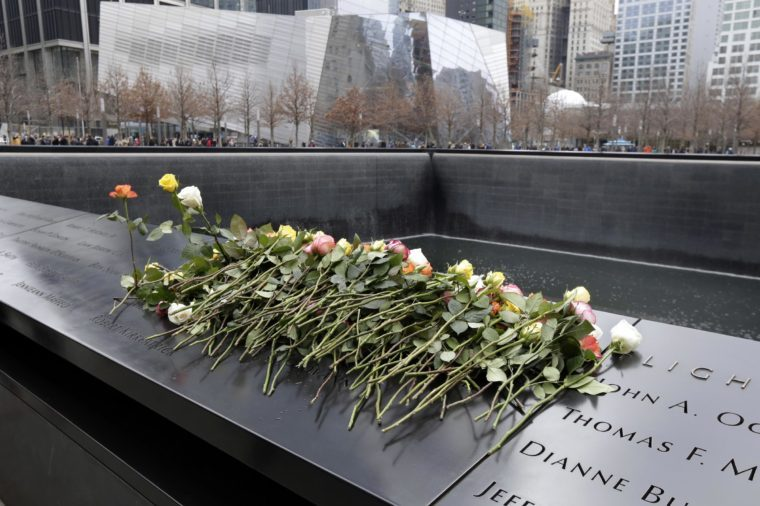 Roses are placed on the 9/11 Memorial during 25th anniversary ceremony to commemorate the six victims of the February 26, 1993 World Trade Center bombing, in New York