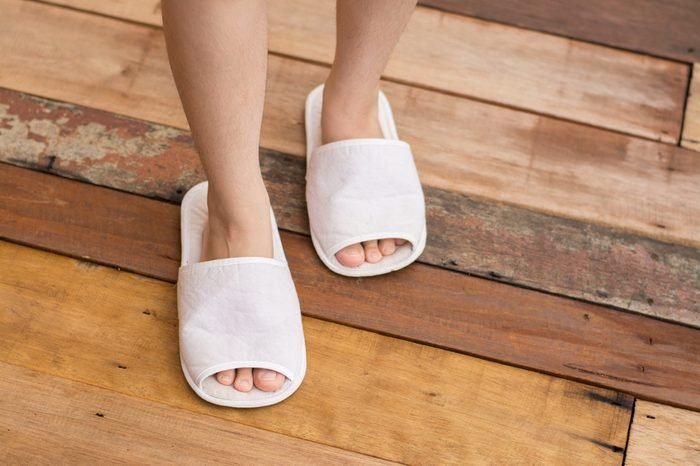 Closeup photo of from woman wearing slippers at morning