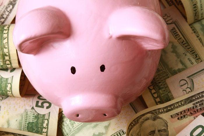 piggy bank on dollars