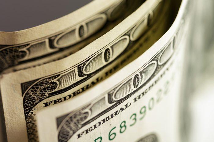 Macro shot of a 100 dollar. Dollars Closeup Concept. American Dollars Cash Money. One Hundred Dollar Banknotes. Hundred Bucks. Benjamin Franklin's portrait.