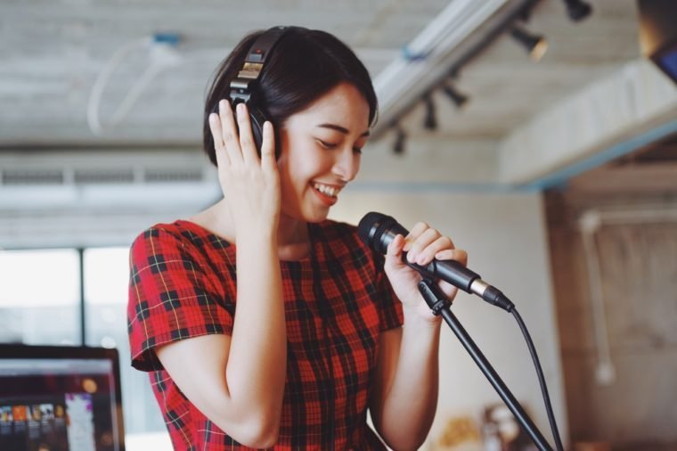 Asian beautiful woman singing in studio