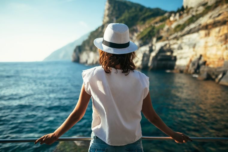 Young beautiful woman relaxing in scenic landscape in Italy. Vacation background