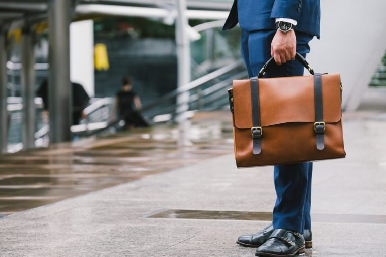 Closeup Of A Businessman Holding leather Briefcase Going To Work