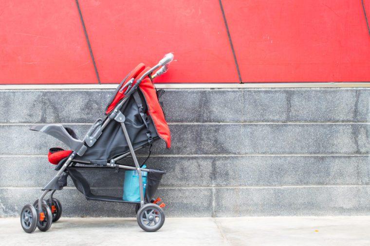 empty red baby Stroller