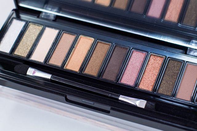 A Palette of Eyeshadow with Many Colors. Cosmetics for Beautification, Make-Up. Comes with a 2-way Brush