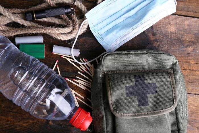 Emergency preparation equipment on wooden background