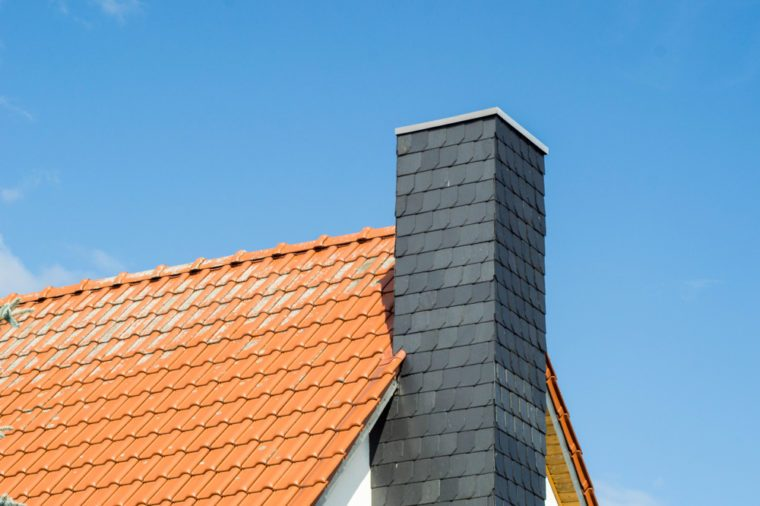 roof and chimney of a house at a sunny day