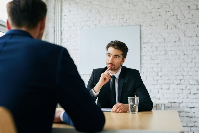 Two businessmen talking during job interview