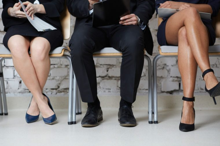 Job interview concept - closeup of business people sitting on chairs