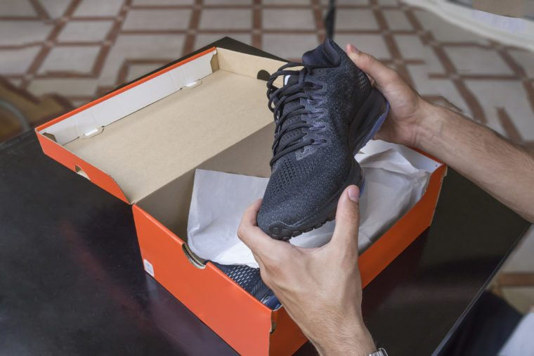 Opening the box of a new pair of shoes