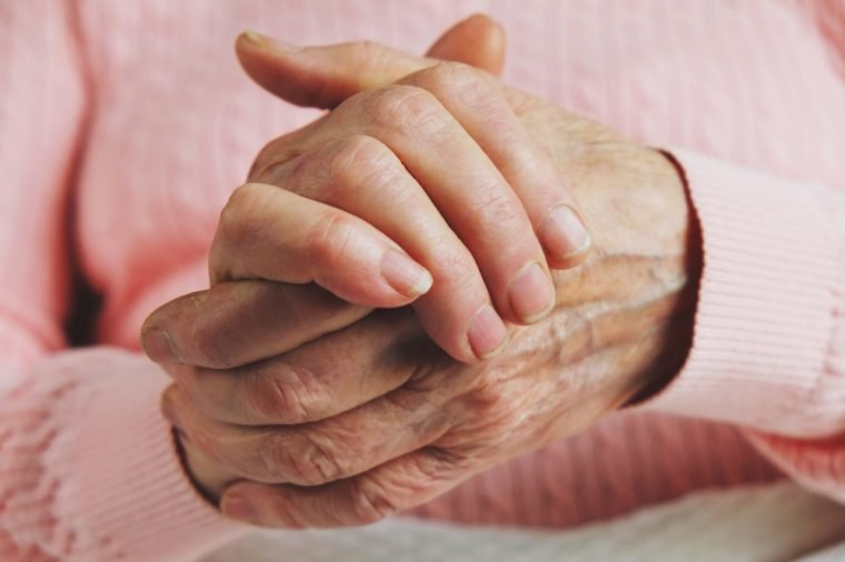 Very old senior woman hands wrinkled skin.
