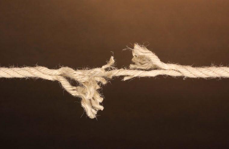 Breaking rope on brown background