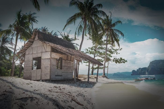 Scenic tropical landscape, El Nido, Palawan, Philippines, Southeast Asia. Beautiful tropical island with hut, sandy beach, palms. Sea bay scenery. Popular landmark, tourist destination of Philippines
