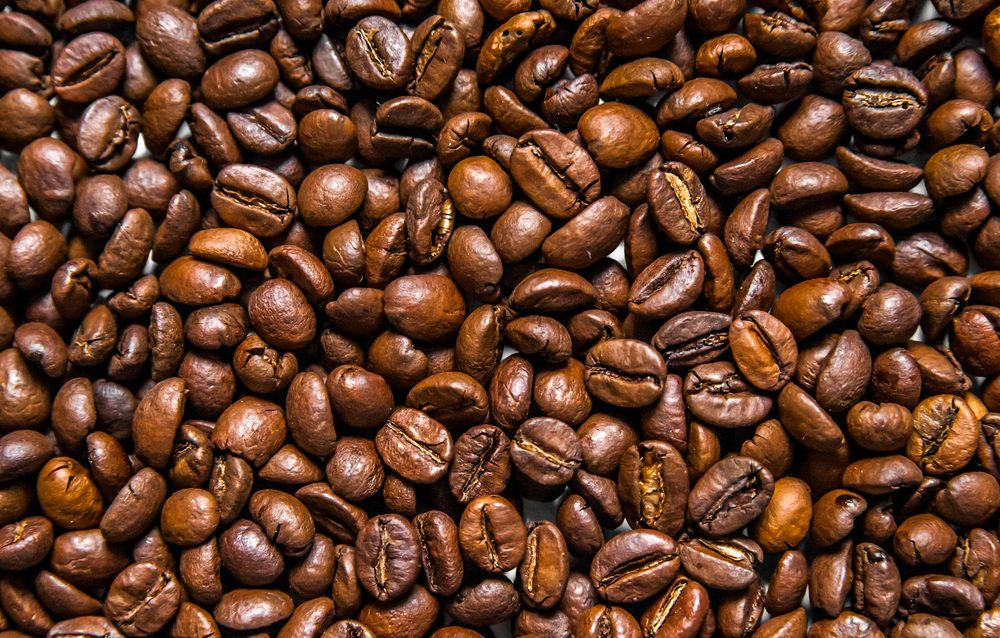 Mixture of different kinds of coffee beans. Coffee Background. roasted coffee beans. coffee beans isolated on white background