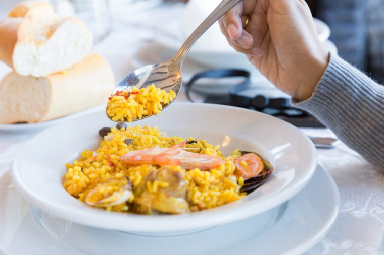 Paella on dish in restaurant at Spain, This traditional spanish seafood with saffron rice, peas, shrimps, mussels, squid, lemon, meat