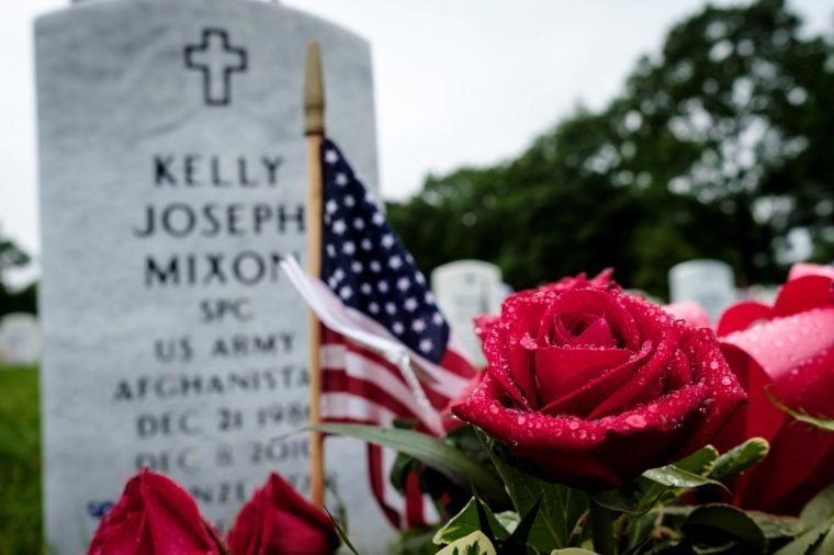 Roses in front of a headstone on Memorial Day in Section 60 at Arlington National Cemetery in Arlington, Virginia, USA, on 28 May 2018. Section 60, is the burial ground in the cemetery where military personnel killed in the Global War on Terror since 2001 are interred.