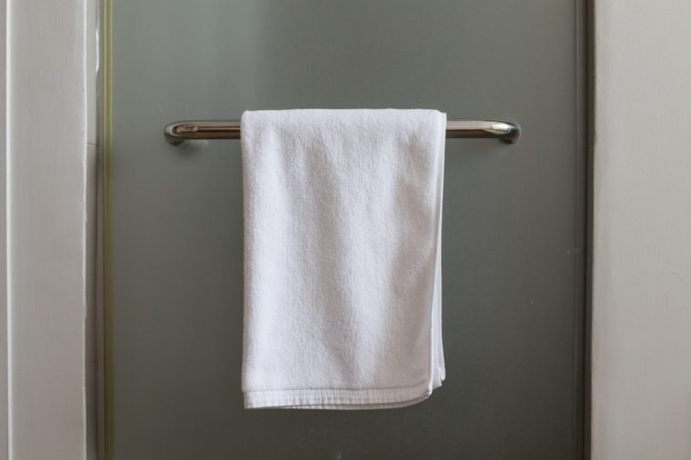 Towel hanging at mirror door in the bathroom.