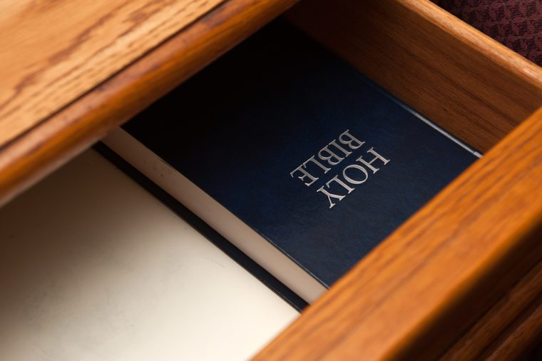 Holy Bible book lying in a open drawer. selective focus on a holy bible sign