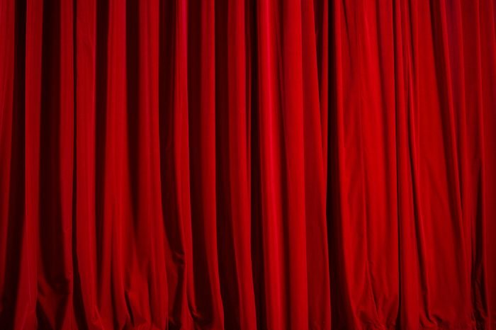 closed theater curtain of red velvet, texture, background