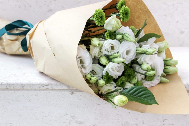 Wrapped white eustoma flowers bouquet