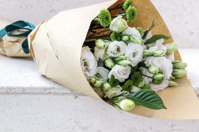 Wrapped white eustoma flowers bouquet