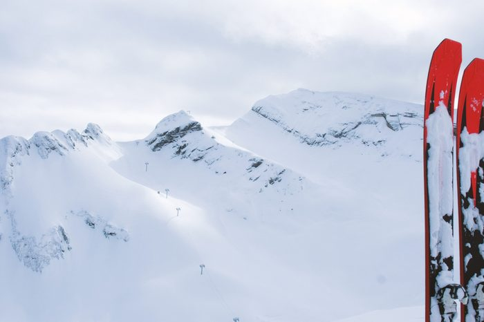 Mountain skiing are on the background of snowy mountains, 4K.