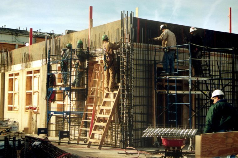 RECONSTRUCTION OF THE PENTAGON FOLLOWING SEPTEMBER 11TH ATTACKS. A WORKER WORKING ON THE CONCRETE WALL WHICH IS DESIGNED TO TO REPLICATE THE LOOK AND FEEL OF THE ORIGINAL 1941 WOODEN PLANK FORMWORK.