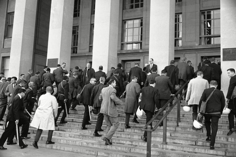 U.S. Marshals carrying night sticks and helmets arrive at the Pentagon in Washington, D.C., . The marshals were ordered to the Pentagon, along with miltary personnel and police, for duty during a planned anti-war demonstration later in the day