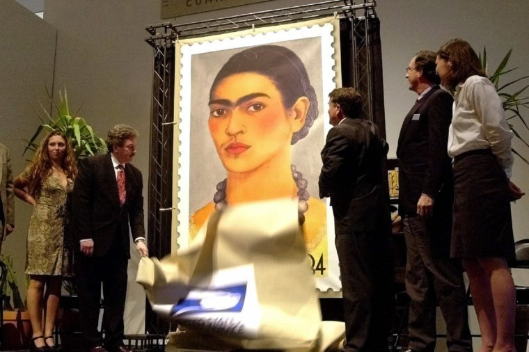 ADAMS Anna Kolokotsas, great granddaughter of Frida Kahlo's uncle, from left, Benjamin Ocasio, vice president of Diversity, USPS, Phoenix, Arizona Mayor Skip Rimsza, James K. Ballinger, director of the Phoenix Art Museum and Dr. Beverly Adams, curator, Latin American Art, Phoenix Art Musuem unveil the United States Postal Service's $.34 stamp of Mexican artist Frida Kahlo at the Phoenix Art Museum in Phoenix. Kahlo, best know for her self portraits, died in 1954. It is the first U.S.stamp to honor a hispanic woman