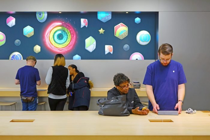 LAWRENCE, NJ -22 JAN 2018- View of customers coming to the Genius Bar in an Apple Store to get batteries replaced on their iPhones. Apple is facing delays in changing the batteries.