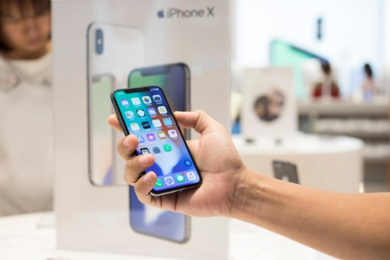 Nakhonratchasrima,Thailand, NOV 27, 2017: A men holding New iPhone X on sale in Apple Store