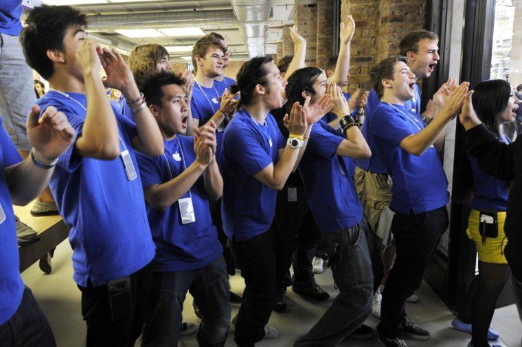 Apple store staff greeting customers