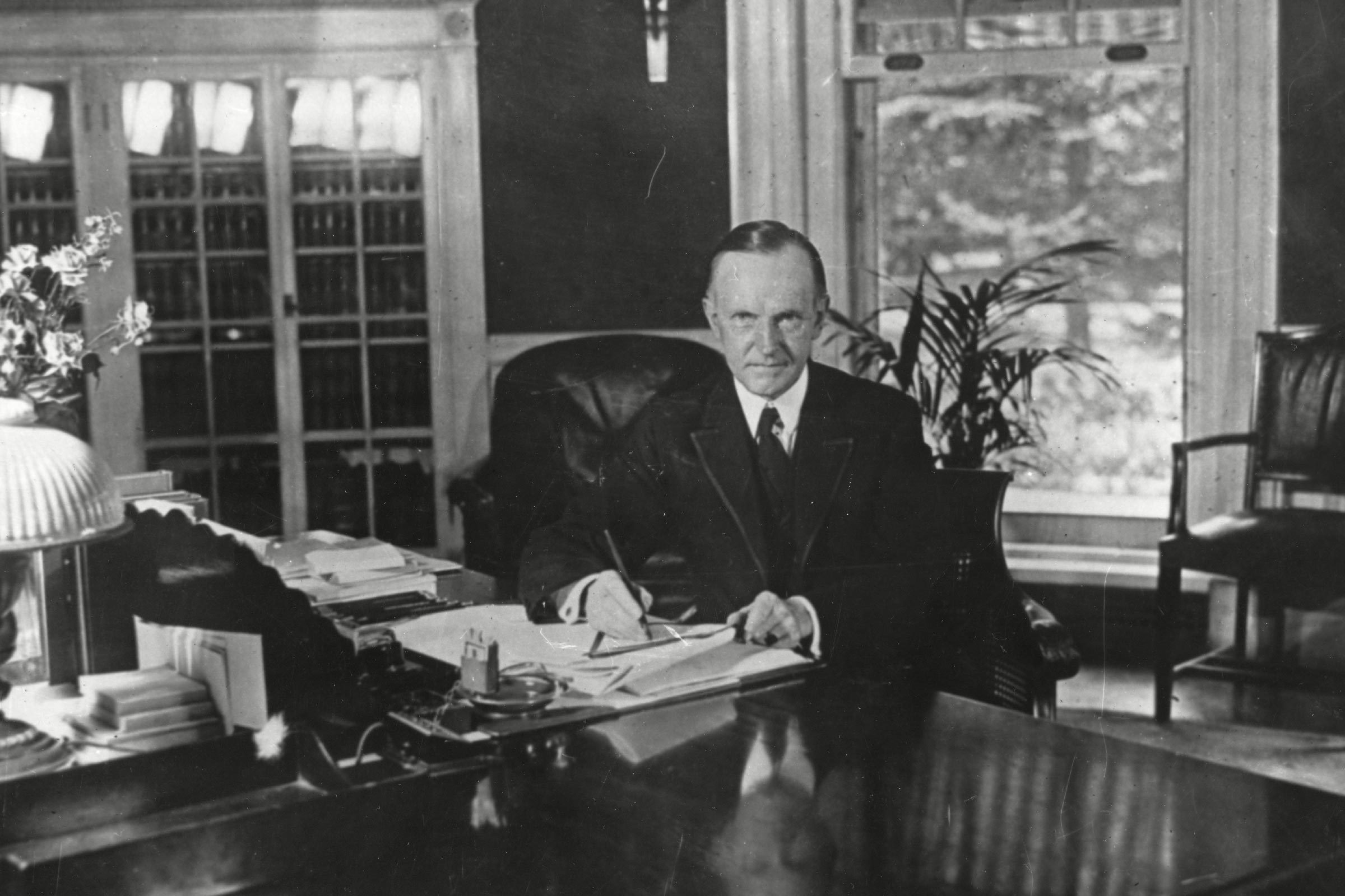 August 15, 1923 - President Calvin Coolidge at his desk in the White House.