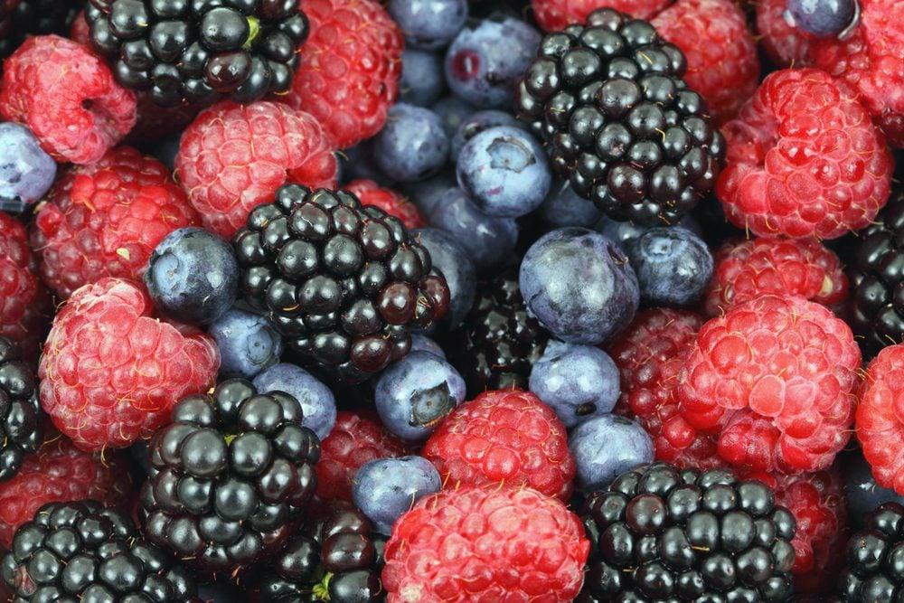 Berries red raspberries, blackberries and blueberries, food background of fresh forest berries.