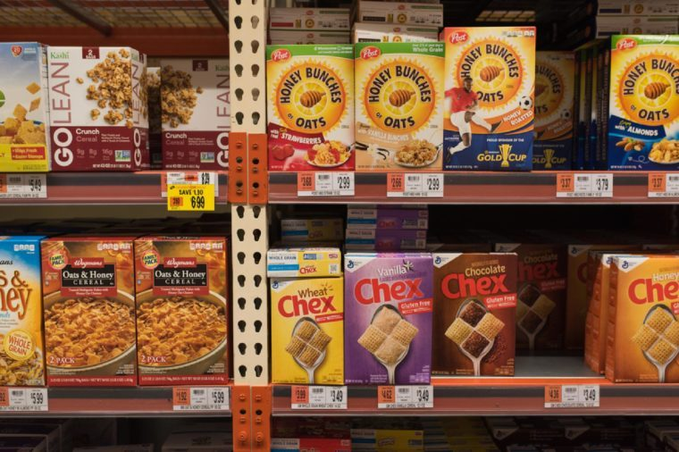 BOSTON, MASSACHUSETTS - MAY 22, 2017: Inside the Wegman's Grocery Store cereal aisle with various cereal brands on the shelves. Gluten Free options at the supermarket or grocery store.