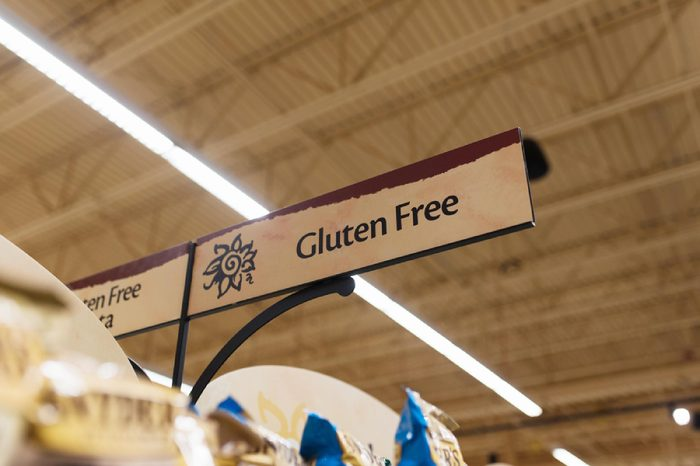 BOSTON, MASSACHUSETTS - MAY 25, 2017: Wegman's gluten free products, snacks, and ingredients for people with Celiac Disease and wheat allergies/sensitivities. Grocery store gluten free section sign