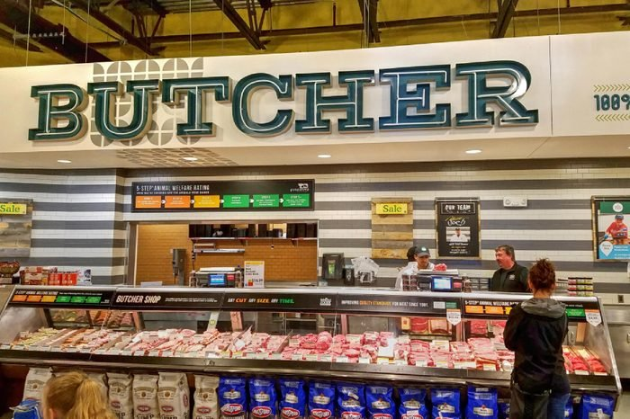 Whole Foods natural organic retail store butcher meat ordering counter, Lynnfield Massachusetts USA, May 11, 2018