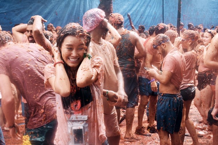BUNOL, SPAIN - AUGUST 30 - A woman in a battle of Tomatoes in La Tomatina Festival, Bunol, Spain in August 30 , 2017