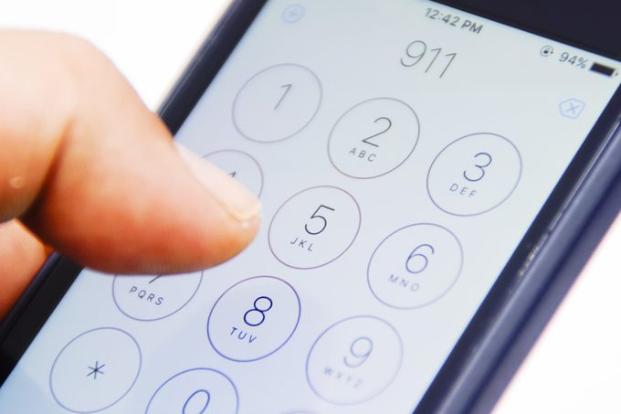 Hand Holding Smartphone With Emergency Number 911 On The Screen