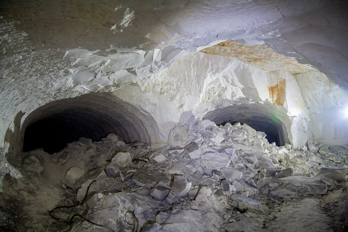 The collapse in the chalk mine, tunnel with traces of drilling machine
