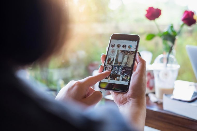 CHIANG MAI, THAILAND - OCT 23, 2017: A woman hand holding iphone with login screen of instagram application. Instagram is largest and most popular photograph social networking.
