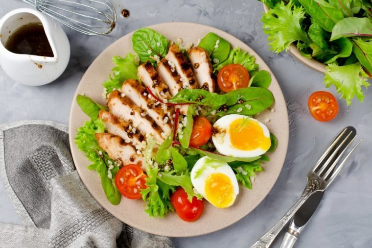 Chicken salad with leaf vegetables, chard, eggs, bulgur and cherry tomatoes