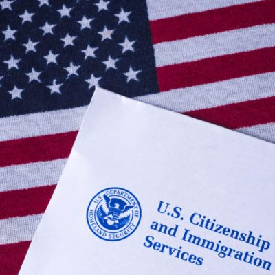 Letter from US Citizenship and Immigration Services on Flag of United States of America.
