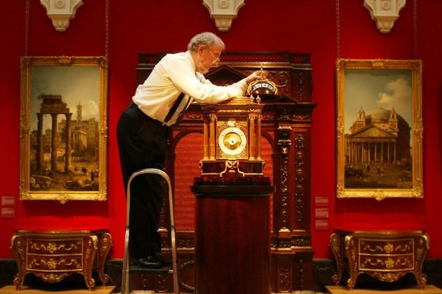 The first exhibition about King George III and Queen Charlotte opens at The Queens Gallery, Buckingham Palace. Robert Ball, the Queens Clockmaker checks the mechanism of the Astronomical clock by Christopher Pinchbeck, the Kings clockmaker, and Sir William Chambers, his architect. One of the most complex clocks in the world it records the time at locations around the world relative to mean time, and high and low water at seaports. The calender dial incorporates a planisphere and the orrery dial includes
