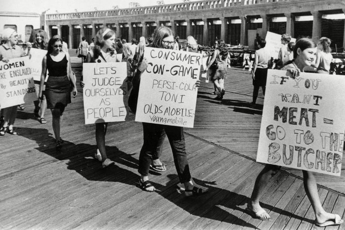 Demonstrators from the National Women's Liberation Party picket with signs in protest of the annual Miss America Pageant in front of the Convention Hall in Atlantic City, N.J., on