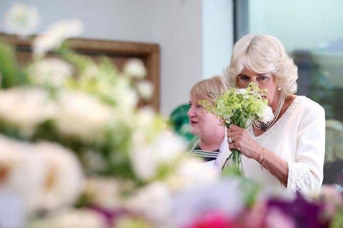 Camilla Duchess of Cornwall helps to create a bouquet with volunteers from Floral Angels during a visit to the Garden Museum to view a British Flowers Week exhibition
