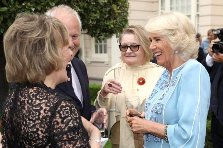 Camilla Duchess of Cornwall talking to Esther Rantzen (l) and Gyles Brandreth and guest at a reception to mark her 70th birthday at Clarence House